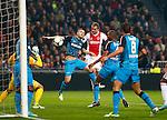Nederland, Amsterdam, 1 december 2012.Seizoen 2012-2013.Eredivisie.Ajax-PSV .Siem de Jong (3e van rechts), aanvoerder van Ajax kopt de 1-0 binnen. Timothy Derijck (3e van links) van PSV en Marcelo Antonio Guedes Filho (2e van rechts) van PSV kunnen zijn inzet niet keren.