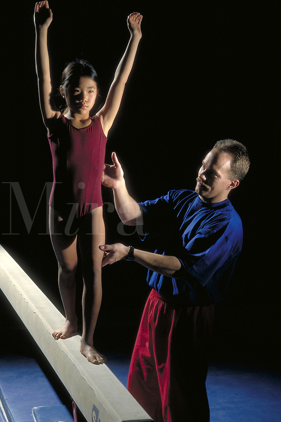 Asian girl and gymnastic instructor