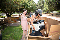 Occidental College's campuswide e-waste collection, with Ellie Amann '19 and Oxy Sustainability Coordinator Jenny Low, in the Academic Quad on Aug. 3, 2017.<br /> (Photo by Marc Campos, Occidental College Photographer)