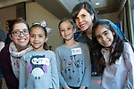 Cynthia Delgadillo, left, with her daughter Abigail, and Lucia López, center right, with her daughter Liliana and their friend Melani, take part in the first Take You Child to Work day hosted by the DePaul Parent Connection employee resource group, Thursday, May 5, 2017, in the Lincoln Park Student Center. The program aimed to encourage, inspire, and empower young children to think and dream about opportunities without limits as they get exposure to careers and professions. (DePaul University/Jeff Carrion)