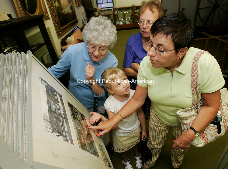WATERTOWN,  CT 04 September 2005 -090405BZ03- From left- Watertown residents Dorothy Harrison, left, her great-granddaughter Megan Gallagher, and her daughters Susan Barnes, and Judy Dayton (Megan's grandmother)<br /> look at old photographs and records of schools and churches during an open house at the Watertown Historical Society Museum Sunday afternoon.<br />  Jamison C. Bazinet / Republican-American