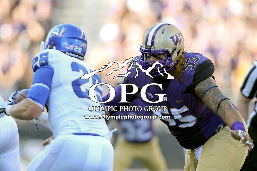 Sept 20, 2014:  Washington's #55 Danny Shelton moves in for a tackle against Georgia State's #25 Kyler Neal.  Washington defeated Georgia State 45-14 at Husky Stadium in Seattle, WA.
