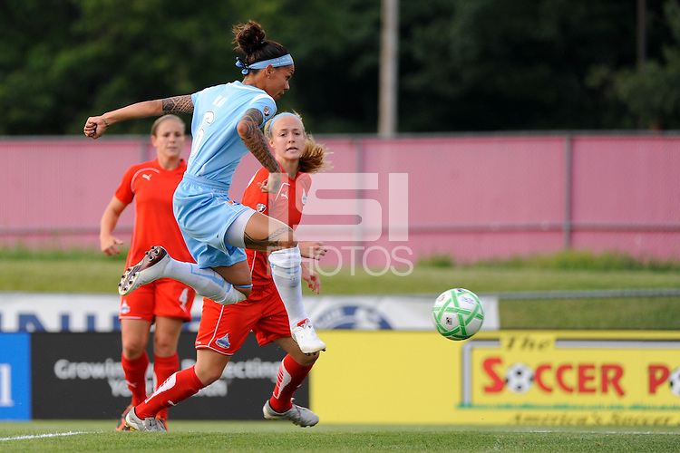 Natasha Kai (6) of Sky Blue FC shoots and scores during a Women's Professional Soccer match against the  Washington Freedom at Yurcak Field in Piscataway, NJ, on July 15, 2009.