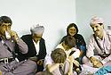 Irak 1991.Nechirvan Barzani reçu chez une famille à Dohok avec Fazel Mirani.Iraq 1991.Nechirvan Barzani visiting a family in Dohok with Fazel Mirani