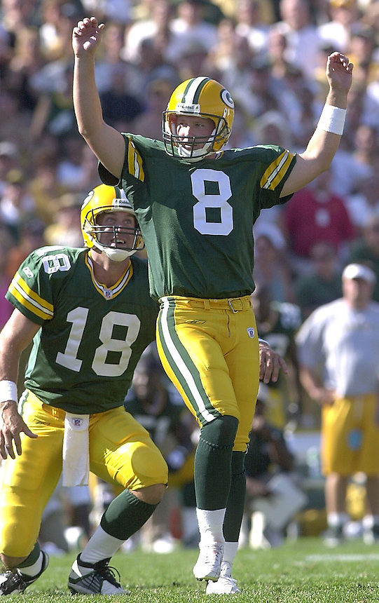 The Green Bay Packers place kicker Ryan Longwell celebrates on Sunday, Sept. 8, 2002 after kicking a winning, sudden-death field goal against the Atlanta Falcons at Lambeau Field. Behind Longwell is holder Doug Pederson. Ernie Mastroianni photo.