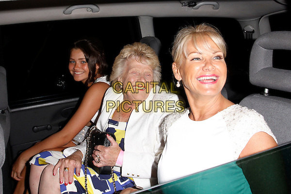 guest, Nanny Pat, Carol Wright <br /> Lipsy VIP Fashion Awards 2013, DSTRKT, London, England.<br /> 29th May, 2013<br /> half length white car sitting side smiling<br /> CAP/AH<br /> &copy;Adam Houghton/Capital Pictures