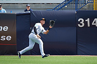 New York Yankees right fielder Aaron Judge (99) catches a fly ball during a Spring Training game against the Detroit Tigers on March 2, 2016 at George M. Steinbrenner Field in Tampa, Florida.  New York defeated Detroit 10-9.  (Mike Janes/Four Seam Images)