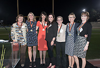 The 1982 National Champion Women's Tennis Team receives their medals. The 1982 women's tennis team won the first NCAA Division III championship in the sport, defeating UC San Diego in Jackson, Miss., in May 1982. Coached by Lynn (Pacala) Mehl, the 11-member squad was led by Jean-Marie Sanders '84, Sue Rene '82, Kathleen McFadden '82, and Maria Newton '85.<br /> The Occidental community celebrates its student-athletes with the induction of the sixth class into the Occidental College Athletics Hall of Fame during Homecoming and Family Weekend on Friday, Oct. 13, 2017 in Jack Kemp Stadium. The 2017 inductees are Stephen Haas '63 (track and field), the 1982 women's tennis team (NCAA national champions), Blair Slattery '94 (basketball and tennis), and the late Andy Collins '07 (football, track and field).<br /> (Photo by Marc Campos, Occidental College Photographer)