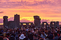 UNITED KINGDOM, STONEHENGE : Revellers celebrate the pagan festival of 'Summer Solstice'  at Stonehenge in Wiltshire in southern England, on June 21, 2015. The festival, which dates back thousands of years, celebrates the longest day of the year when the sun is at its maximum elevation. Modern druids and people gather at the landmark Stonehenge every year to see the sun rise on the first morning of summer.