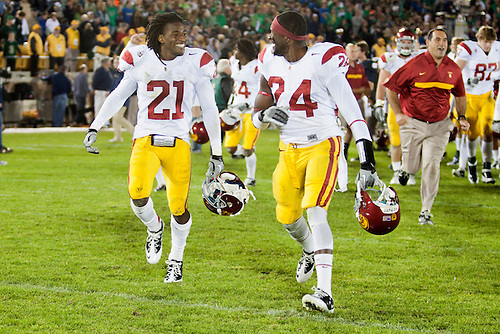 USC cornerback Nickell Robey (#21) and USC safety Demetrius Wright (#24) celebrate after NCAA football game between Notre Dame and USC.  The USC Trojans defeated the Notre Dame Fighting Irish 31-17 in game at Notre Dame Stadium in South Bend, Indiana.