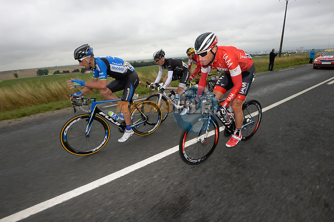 The breakaway group featuring Bartosz Huzarski (POL) Netapp-Endura, Martin Elmiger (SUI) IAM Cycling, Matthew Busche (USA) Trek and Nicolas Edet (FRA) Cofidis during Stage 7 of the 2014 Tour de France running 234.5km from Epernay to Nancy. 11th July 2014.<br /> Photo ASO/G.Demouveaux/www.newsfile.ie