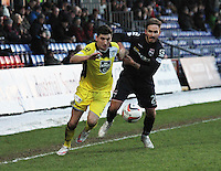 Kenny McLean gets round Martin Woods in the Ross County v St Mirren Scottish Professional Football League match played at the Global Energy Stadium, Dingwall on 17.1.15.