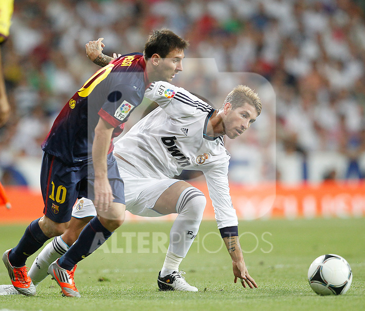 Real Madrid's Sergio Ramos and F.C. Barcelona's Lionel Messi during Spanish Supercup 2nd match on august 29 2012...Photo: Cesar Cebolla / ALFAQUI