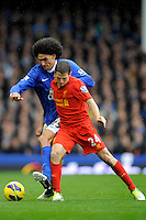 28.10.2012 Liverpool, England. Joe Allen of Liverpool and  Marouane Fellaini of Everton  in action during the Premier League game between Everton and Liverpool  from Goodison Park ,Liverpool