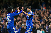 Willian of Chelsea & Diego Costa of Chelsea celebrate there team taking a 1-0 lead through an Own Goal during the UEFA Champions League group G match between Chelsea and FC Porto at Stamford Bridge, London, England on 9 December 2015. Photo by Andy Rowland.