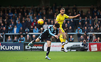 Joe Jacobson of Wycombe Wanderers and Kemar Roofe of Oxford United during the Sky Bet League 2 match between Wycombe Wanderers and Oxford United at Adams Park, High Wycombe, England on 19 December 2015. Photo by Andy Rowland.