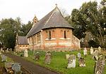 Holy Trinity Village parish church Oare, Wiltshire, England, UK built 1858 red brick Victorian nineteenth century building