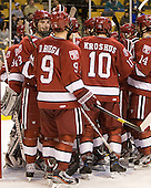 Patrick McNally (Harvard - 8), Danny Biega (Harvard - 9) - The Harvard University Crimson defeated the Northeastern University Huskies 3-2 in the 2012 Beanpot consolation game on Monday, February 13, 2012, at TD Garden in Boston, Massachusetts.