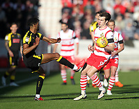 Rotherham United's Michael Ihiekwe raises a boot in a tackle with Doncaster Rovers' John Marquis<br /> <br /> Photographer Mick Walker/CameraSport<br /> <br /> The EFL Sky Bet League One - Doncaster Rovers v Rotherham United - Saturday 11th November 2017 - Keepmoat Stadium - Doncaster<br /> <br /> World Copyright &copy; 2017 CameraSport. All rights reserved. 43 Linden Ave. Countesthorpe. Leicester. England. LE8 5PG - Tel: +44 (0) 116 277 4147 - admin@camerasport.com - www.camerasport.com