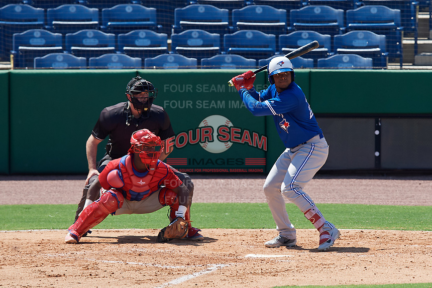 Toronto Blue Jays PK Morris (21) at bat in front of catcher Juan Mendez (8) during an Instructional League game against the Philadelphia Phillies on September 17, 2019 at Spectrum Field in Clearwater, Florida.  (Mike Janes/Four Seam Images)