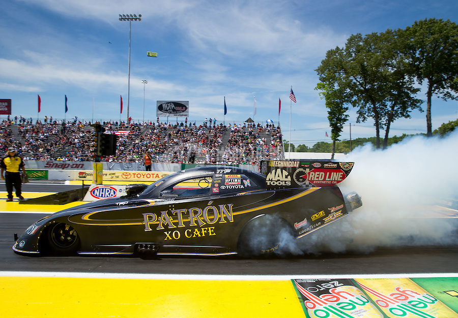 Jun. 1, 2014; Englishtown, NJ, USA; NHRA funny car driver Alexis DeJoria during the Summernationals at Raceway Park. Mandatory Credit: Mark J. Rebilas-