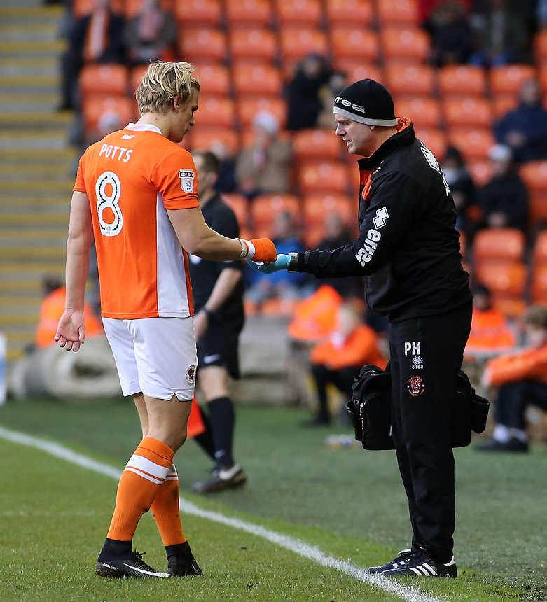 Blackpool's Brad Potts gives his tooth to physio Phil Horner<br /> <br /> Photographer David Shipman/CameraSport<br /> <br /> The EFL Sky Bet League Two - Blackpool v Luton Town - Saturday 17th December 2016 - Bloomfield Road - Blackpool<br /> <br /> World Copyright &copy; 2016 CameraSport. All rights reserved. 43 Linden Ave. Countesthorpe. Leicester. England. LE8 5PG - Tel: +44 (0) 116 277 4147 - admin@camerasport.com - www.camerasport.com
