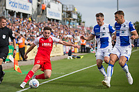 Lewis Coyle of Fleetwood Town keeps the ball in under pressure from Ollie Clarke and Lee Brown of Bristol Rovers during the Sky Bet League 1 match between Bristol Rovers and Fleetwood Town at the Memorial Stadium, Bristol, England on 26 August 2017. Photo by Mark  Hawkins.