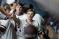 Rowdey Jordan (4) of the Mississippi State Bulldogs high fives a teammate in the dugout during the game against the Houston Cougars in game six of the 2018 Shriners Hospitals for Children College Classic at Minute Maid Park on March 3, 2018 in Houston, Texas. The Bulldogs defeated the Cougars 3-2 in 12 innings. (Brian Westerholt/Four Seam Images)