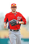 6 March 2012: Washington Nationals outfielder Bryce Harper returns to the dugout during a Spring Training game against the Atlanta Braves at Champion Park in Disney's Wide World of Sports Complex, Orlando, Florida. The Nationals defeated the Braves 5-2 in Grapefruit League action. Mandatory Credit: Ed Wolfstein Photo