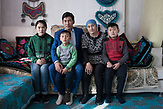 Karakastaq village, Jambyl region, South Kazakhstan.  Aman Ansagan and Gulziya Mogden,  children, from left to right - Kausar Muratbek, Beybarys Aman (he was in an orphanage), Sunkar Muratbek.   They are migrants from China and kazakhstan citizens now. Gulziya went back to Xinjiang, China for some family business with her kids. Crossing the border she got her passport confiscated, one kid was sent to an orphanage, another to her relative. Then she was forced to make an abortion in local hospital. Finally, chinese authorities let her come back to Kazakhstan with her children. 2 of her brothers arrested and sent to concentration camp along with 60 fellow countrymen and women.
