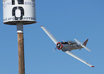 Chris Rushing from Van Nuys CA. flying Barons Revenge in the T-6 class during the National Championship Air Races at the Reno-Stead Airfield Sunday, Sept. 20, 2015.