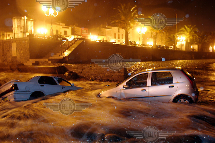 Several cars were swept away by floods caused by heavy rain. French seaside town of Collioure experienced dramatic weather change at the end of holiday season.