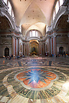 """The interior of this ancient basilica was once part of the biggest """"terme"""" in ancient Rome - Terme di Diocleziano. It was transformed into the S. Maria degli Angeli and dei Martiri church in XVI century according to Michelangelo project. This ancient basilica is standing beside Piazza della Repubblica in Rome, Italy."""