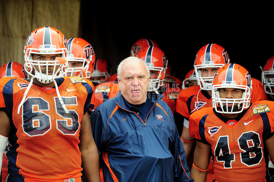 Dec. 18, 2010; Albuquerque, NM, USA; UTEP Miners head coach Mike Price is surrounded by offensive lineman (65) Anthony McNac and linebacker (48) Aubrey Alexius against the BYU Cougars in the 2010 New Mexico Bowl at University Stadium. BYU defeated UTEP 52-24. Mandatory Credit: Mark J. Rebilas-