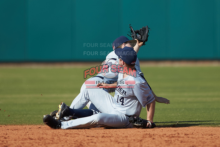 Sam Flamini (14) and Chris Givin (35) of the Xavier Musketeers run into each other while trying to make a play on a fly ball against the Penn State Nittany Lions at Coleman Field at the USA Baseball National Training Center on February 25, 2017 in Cary, North Carolina. The Musketeers defeated the Nittany Lions 10-4 in game one of a double header. (Brian Westerholt/Four Seam Images)