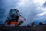 Montana,Whitefish. The historic Daylight 4449 steam engine of the Southern Pacific Line steams in the pre-dawn light while on its western leg of a cross country excursion.