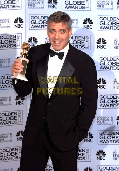 "GEORGE CLOONEY.HFPA 63rd Golden Globe Awards at The Beverly Hills Hilton, Beverly Hills, California, USA..Awarded ""Best Supporting Actor"" for Syriana.January 16th, 2006.Ref: PL .globes half length award trophy.www.capitalpictures.com.sales@capitalpictures.com.©Phil Loftus/Capital Pictures"
