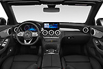Stock photo of straight dashboard view of 2019 Mercedes Benz C-Class AMG-Line 2 Door Convertible Dashboard