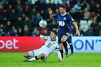 George Byers of Swansea City battles with Corry Evans of Blackburn Rovers during the Sky Bet Championship match between Swansea City and Blackburn Rovers at the Liberty Stadium in Swansea, Wales, UK. Wednesday 11 December 2019