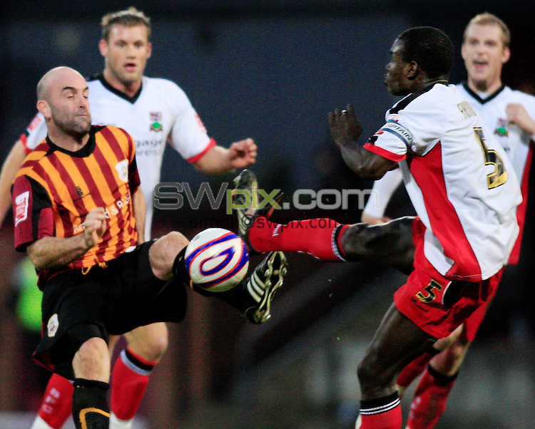 Pix: Chris Mangnall/SWpix.com, Football   Coca-Cola Division Two. 01/11/08. Bradford City v Barnet....picture copyright>>Simon Wilkinson>>07811267 706>>....Barnet's Ishmail Yakubu recives yellow card for this chalenge for the Ball with Brabford's  Barry Conlon
