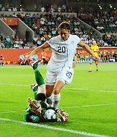 Abby Wambach of team USA and goalkeeper Hedvig Lindahl of team Sweden during the FIFA Women's World Cup at the FIFA Stadium in Wolfsburg, Germany on July 6thd, 2011.