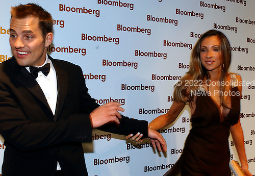 """Washington, DC - May 1, 2004 -- Katrina Campins, right, seems to be pulling Bill Rancic, left,  into the Bloomberg party following the 2004 White House Correspondents Association Dinner in Washington, D.C. on May 1, 2004.  Both starred in the NBC reality series """"The Apprentice"""" with Donald Trump..Credit: Ron Sachs/ CNP.(RESTRICTION: No New York Metro or other Newspapers within a 75 mile radius of New York City)"""