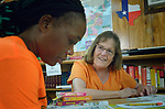 Randie Clawson, a member of United Methodist Women from Traverse City, Michigan, teaches English as a Second Language to Melania Kamuanya, an asylum seeker from Angola, at the Posada Providencia, a shelter in San Benito, Texas. Sponsored by the Catholic Sisters of Divine Providence, the shelter provides a safe place for people in crisis from all over the world who are seeking legal refuge in the United States.