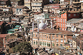 Shimla, Himachal Pradesh, India. View of the jumble of buildings cascading down the hillside which form the centre of the city with the Jama Masjid Mosque in the centre.