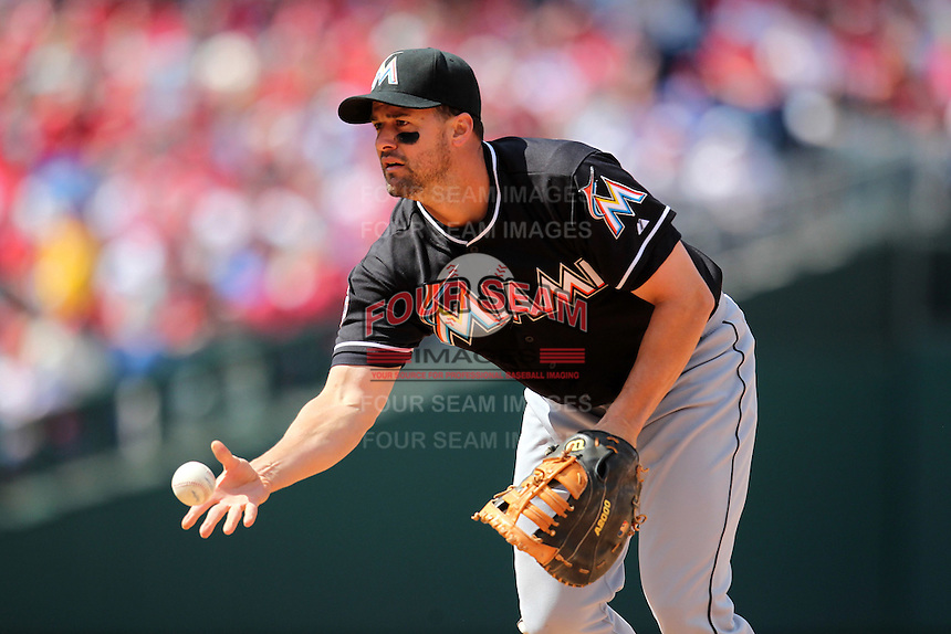 Miami Marlins first baseman Gabby Sanchez #15 flips the ball to first during a game against the Philadelphia Phillies at Citizens Bank Park on April 9, 2012 in Philadelphia, Pennsylvania.  Miami defeated Philadelphia 6-2.  (Mike Janes/Four Seam Images)