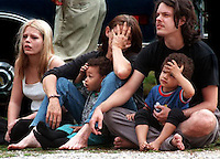 Amber Landam, 16, Donna Landham, Andrea Landham,3, Jerry Owens, and Billy Landham,3, watch as fire fighters battle a blaze which engulfed their home at Strong and W Street Monday morning. Fire departments from West Pensacola, Myrtle Grove, Navy, Pensacola and Warrington responded to the blaze which took several hours to battle.