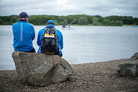 Glasgow, Scotland, Friday, 4th  August 2018, Two Italian Coaches, watch the racing from the comfort of a rock,  The European Games, Rowing, Strathclyde Park, North Lanarkshire, © Peter SPURRIER/Alamy Live News