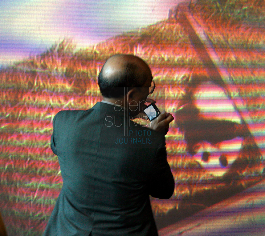 Jung Mar takes a photo of a live video broadcast showing Zoo Atlanta's giant panda cub during a ceremony to announce the cub's name. ?Mei Lan,? which translates to ?Atlanta Beauty? won in an online poll, receiving 22% of the 57,015 votes cast. Voters were given a list of 10 names from which to choose. The names were suggested by several institutions interested in panda conservation including local media, Zoo Atlanta staff and volunteers, Panda Express (a Zoo Atlanta sponsor) and the people of China.<br />