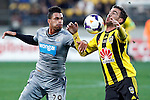 Wellington Phoenix's Manny Muscat, right takes the ball on the chest as Newcastle United's Emmanuel Riviere, left, looks on in the fourth match of the Football United Tour at Westpac Stadium, Wellington, New Zealand, Saturday, July 26, 2014. Credit: Dean Pemberton