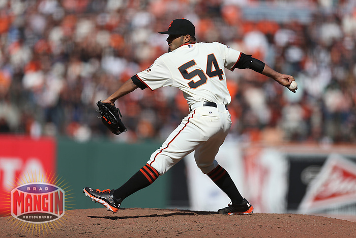 SAN FRANCISCO, CA - APRIL 5:  Sergio Romo #54 of the San Francisco Giants pitches against the St. Louis Cardinals during opening day at AT&T Park on Friday, April 5, 2013 in San Francisco, California. Photo by Brad Mangin